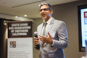 Presenter talking to lawyers at SABA event in Los Angeles